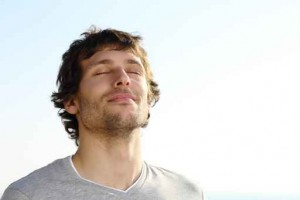 Attractive man breathing outdoor